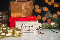 New years and christmas deco, written its xmas time on wooden desk Stock Images