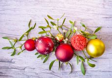 New Years and Christmas decorations with mistletoe on wooden background stock photography