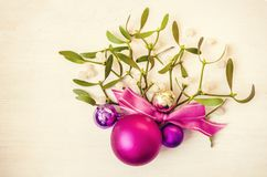 New Years and Christmas decorations with mistletoe on wooden background royalty free stock image