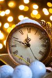 New Years clock and white balls covered with lights royalty free stock photos