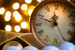 New Years clock and white balls covered with lights royalty free stock photography