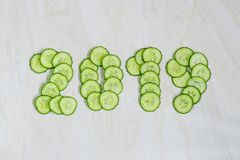 New Years collage, healthy way of life, figures from cucumber.  royalty free stock photos
