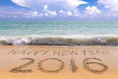 New Years 2016. Is coming concept, Happy  on the sand beach Royalty Free Stock Images