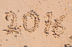 New Years 2016 concept; 2016 on the sand background Texture Royalty Free Stock Image