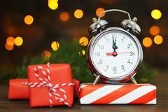 New Years Eve. Midnight clock and gifts royalty free stock photo