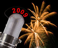 New Years Eve 2009 Fireworks. 2009 message on vintage microphone with fireworks in the background.  This image conveys the concept of 2009 New Years Celebrations Stock Photo