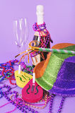 New Years Eve 2011 party still life. New Years Eve 2011 still life with champagne bottle and champagne flutes, noisemakers, horn, party hat, beads and copy space stock images