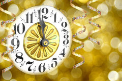 New Years Eve. Party - clock with streamers and abstract light background Royalty Free Stock Photography