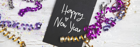 New Years Eve Background with black card. An wooden background Stock Image