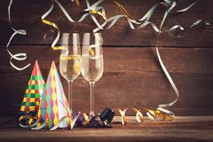 New years eve background. New years eve decoration with champaign glasses and streamer royalty free stock photo