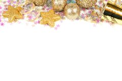 New Years Eve border isolated. New Years Eve border of confetti and golden decorations on a white background royalty free stock photo