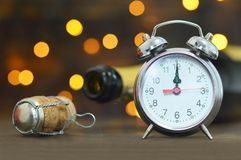 New Years Eve celebration. Midnight clock and champagne stock photography