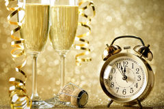 New years eve celebration. Background with champagne and alarm clock Royalty Free Stock Image