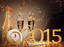2015 New Years Eve celebration background. With an elegant arrangement with a clock counting down to midnight, flutes and bottle of champage and party streamers Stock Image