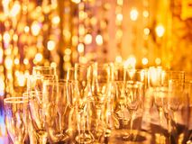 New years eve celebration background with glasses of champagne. Vintage gold Fireworks and bokeh in New Year eve and copy space. A. Bstract background holiday royalty free stock images