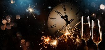 New Years Eve celebration background. Toast with fireworks and champagne at midnight Royalty Free Stock Photo