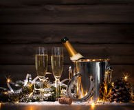 New Years Eve celebration. Background with pair of flutes and bottle of champagne in  bucket  and a horseshoe as lucky charm Stock Photography