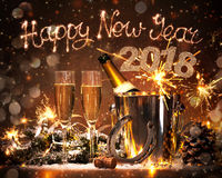 New Years Eve celebration. Background with pair of flutes and bottle of champagne in  bucket  and a horseshoe as lucky charm Royalty Free Stock Image