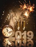 New Years Eve celebration. Background with pair of flutes, bottle of champagne and a clock royalty free stock images