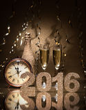 New Years Eve celebration. Background with pair of flutes, bottle of champagne and a clock Stock Photography