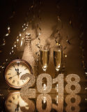 New Years Eve celebration. Background with pair of flutes, bottle of champagne and a clock Royalty Free Stock Photo