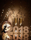 New Years Eve celebration. Background with pair of flutes, bottle of champagne, clock and a chimney sweep as lucky charm Royalty Free Stock Image