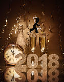 New Years Eve celebration. Background with pair of flutes, bottle of champagne, clock and a chimney sweep as lucky charm Royalty Free Stock Photo
