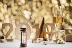 New Years Eve celebration background with pair of flutes, bottle. Of champagne stock photos