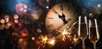 New Years Eve celebration background. Toast with fireworks and champagne at midnight Royalty Free Stock Photography