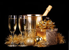 New Years Eve. Celebration. Champagne and Presents over black. Background Stock Photography