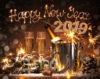 New Years Eve celebration. Background with pair of flutes and bottle of champagne in  bucket  and a horseshoe as lucky charm Royalty Free Stock Photography