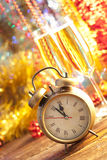 New Years Eve - champagne, clock and serpentine Stock Photos