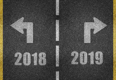 New years Eve concept in 2018. A tarmacadam road inscribed with a 'dotted' white (gray) center line and on the left 2018 and on the right 2019 with appropriate vector illustration