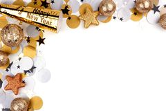 New Years Eve corner border of confetti and decor over white. New Years Eve corner border of confetti and decor isolated on a white background stock photos