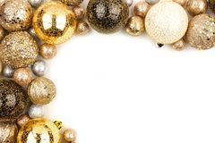 New Years Eve corner border of gold, black and white ornaments over white stock photo