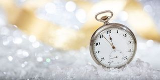 New Years eve countdown. Minutes to midnight on an old pocket watch, bokeh background. Copy space royalty free stock photography