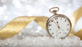 New Years eve countdown. Minutes to midnight on an old watch, bokeh festive background. Banner stock photos
