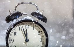 New Years eve countdown. Minutes to midnight on a vintage alarm clock. Closeup view stock images