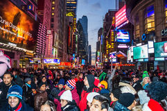 New Years Eve Crowd 2014. NEW YORK-DECEMBER 31: Crowds of people gathering in Times Square hours before midnight on December 31, 2014 in Manhattan Royalty Free Stock Photography