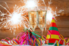 New years eve. Decoration with champaign glasses and fireworks Stock Photos