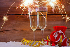 New years eve. Decoration with champaign glasses and fireworks Stock Photo