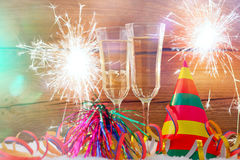 New years eve. Decoration with champaign glasses and fireworks Stock Photography