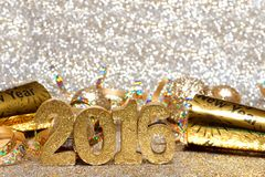 New Years Eve 2016 decorations with twinkling light background. New Years Eve 2016 golden numbers and decorations with twinkling light background Stock Image