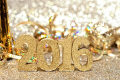 New Years Eve 2016 decorations with twinkling light background Royalty Free Stock Photography