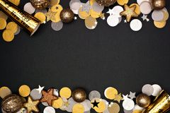 Free New Years Eve Double Border Of Confetti, Decorations And Noisemakers, Top View Over A Black Background Royalty Free Stock Images - 164694229