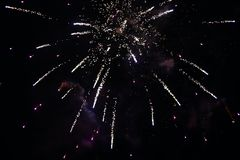 New Years Eve fireworks. Several rockets exploding colourfully with many sparks in the beautiful night sky