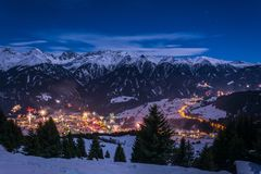 New Years Eve fireworks over village Fiss in Austria with snowy. Mountains and stars stock photos