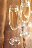 New Years Eve - glasses of champagne. On wooden table Royalty Free Stock Image