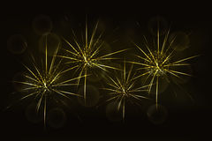 New years eve golden fireworks with blurred glowing golden bokeh. Effect on backdrop. Celebration firework in yellow colors with abstract rounded or circular Royalty Free Stock Images