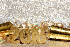 New Years Eve 2018 golden numbers and decor. Ations with twinkling light background Stock Photography